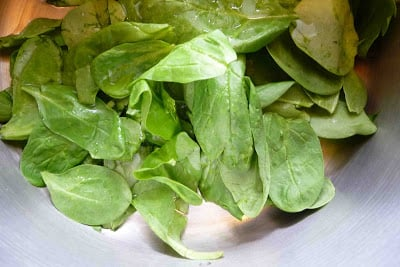 Spinach leaves in saucepan