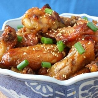 Soy honey chicken wings in a blue decorated bowl