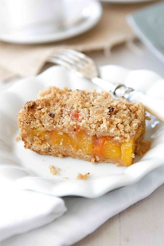 The sweetness of summertime peaches shin through in these peach crumbs bars, topped with a delightful crumbly hazelnut streusel.