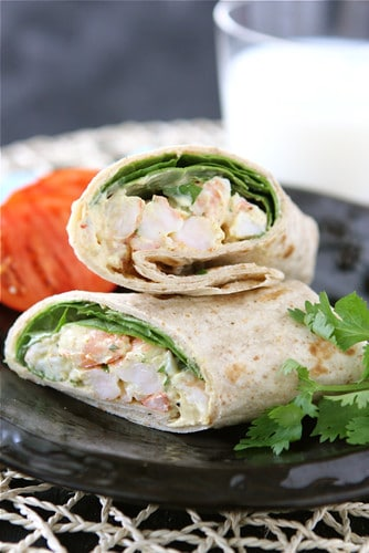 This healthy shrimp sandwich wrap gets a flavor twist with the addition of an easy curry yogurt sauce. Great light lunch recipe! #shrimp #sandwich