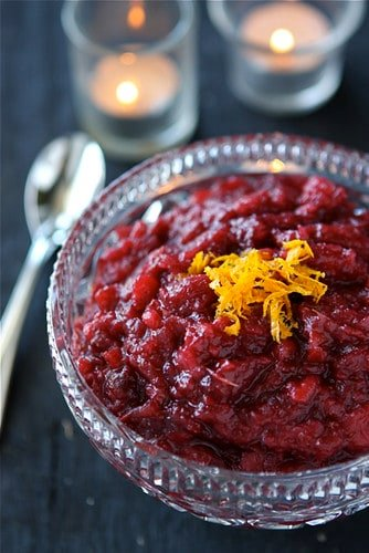 This Crockpot Apple Cranberry Sauce is spiked with orange and crystallized ginger. Fantastic with roast turkey! #crockpot #cranberrysauce