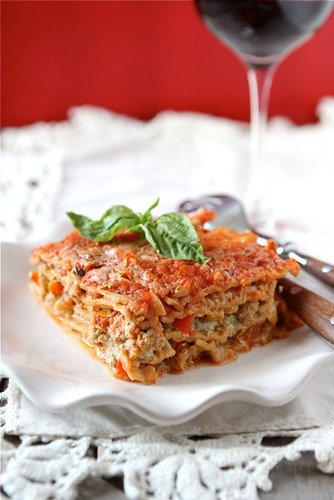 This healthy lasagne recipe is livened up with basil pesto and sauteed bell peppers. A fun take on a classic favorite. #lasagna #lasagne #healthyrecipes