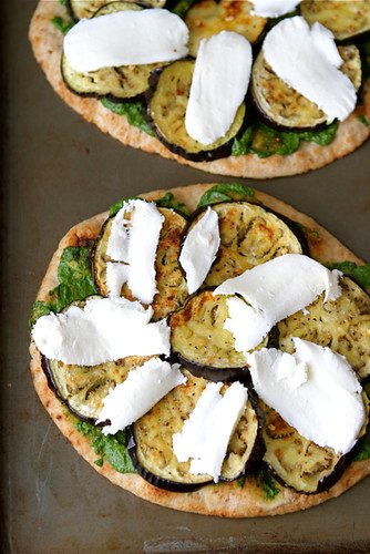 Pair homemade cilantro jalapeno pesto with roasted eggplant and you have a vegetarian naan pizza that will blow your mind! #pizzarecipes #vegetarian #eggplant