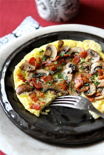 Make this fantastic frittata recipe as a lunch for one or double or triple the recipe for weekend brunch with the family. Pancetta, mushrooms and roasted garlic make everything better! #frittata #eggrecipes #brunch
