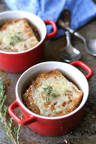 Salty, crumbly pancetta and endive elevate this French onion soup recipe to something really special. Hearty, comforting and lightened up! #frenchonionsoup #soup #endive