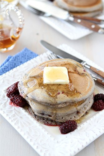 These whole wheat pancakes are a weekend brunch favorite! Spiced with ground ginger and packed with berries, they're both easy and healthy.