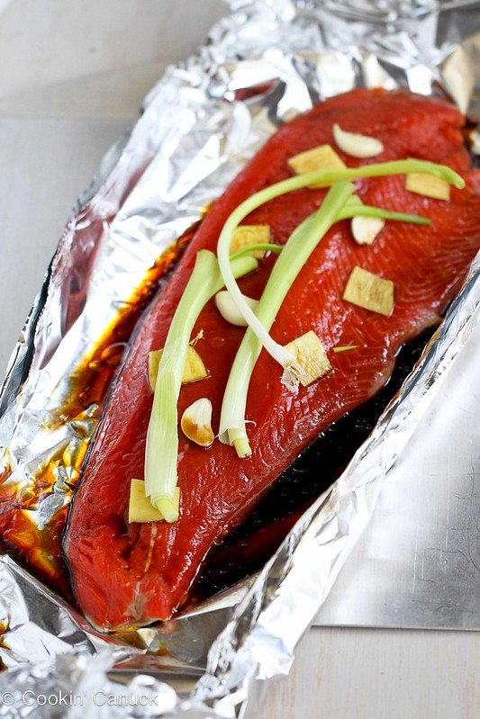 Salmon fillet in foil, topped with soy sauce mixture, ginger, garlic and green onions.