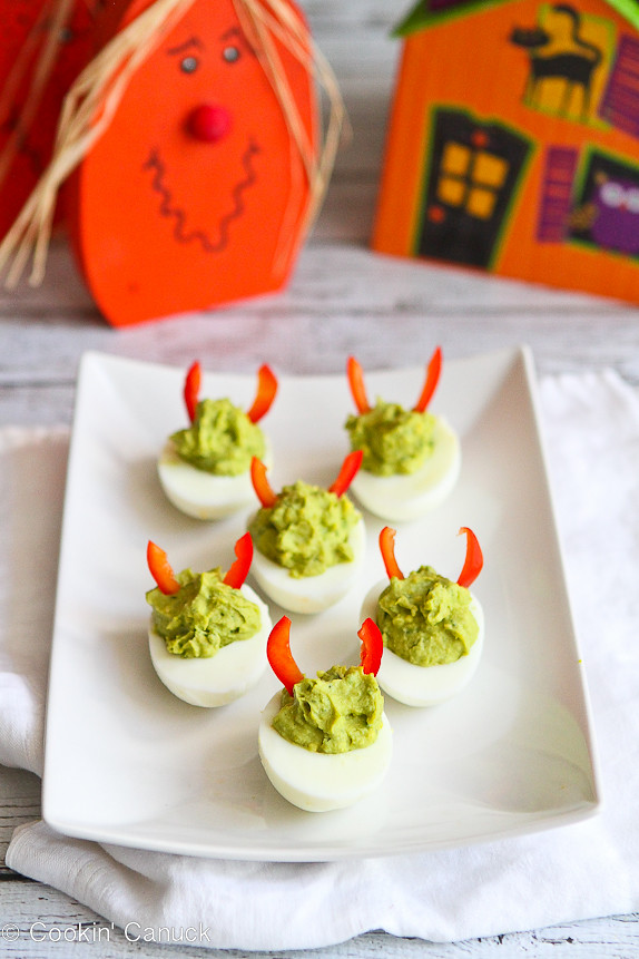 These mayo-less avocado deviled eggs are all dressed up for Halloween, but are fantastic snacks or appetizers any old time. 52 calories and 1 Weight Watchers Freestyle SP #eggs #Halloween