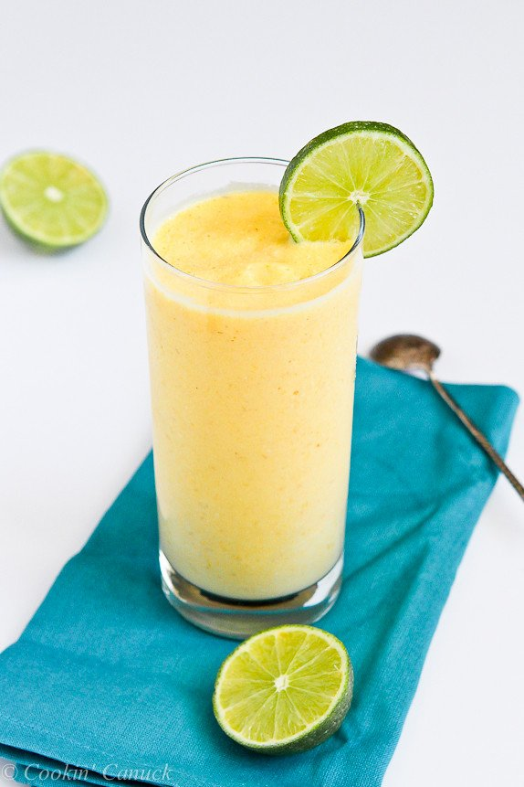 Tropical Mango & Pineapple Smoothie Recipe...A touch of the tropics in a glass. | cookincanuck.com