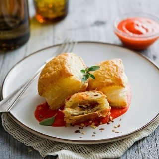 "Guest Post for White on Rice Couple: Pancetta, Caramelized Onion Puff Pastry ""Ravioli"" Recipe with Roasted Red Pepper Sauce"