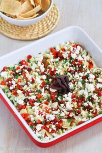 Put a fresh spin a classic appetizer recipe with this Healthy Mediterranean 7-Layer Dip. Perfect for afternoon snacking or game day! 49 calories and 1 Weight Watchers Freestyle SP #7layerdip #healthyappetizer