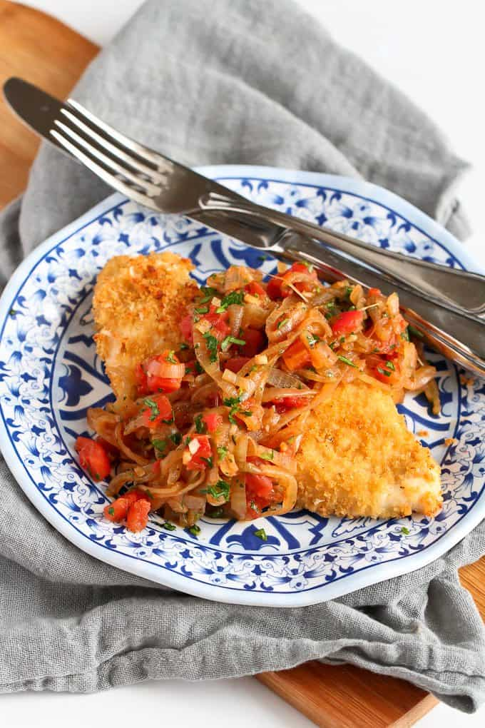 This baked crispy chicken is topped with a fantastic sweet and savory mix of caramelized onions, tomatoes and herbs. 289 calories and 4 Weight Watchers Freestyle SP
