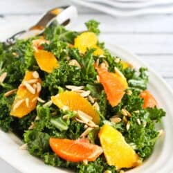 This kale salad recipe features the sweetest seasonal oranges, crunchy toasted almonds and a light Dijon vinaigrette. Plus, 5 of my favorite salad recipe ideas! 156 calories and 3 Weight Watchers Freestyle SP #weightwatchers #kale #salad
