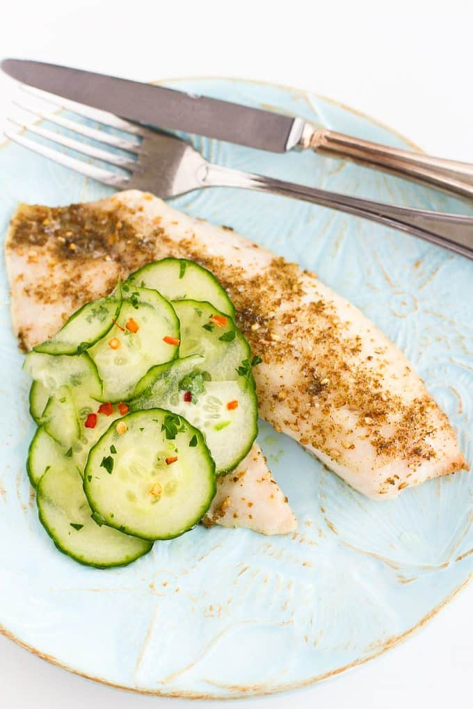 Roasted Za'atar Tilapia with Pickled Cucumbers…It may sound fancy, but this healthy tilapia recipe takes less than 30 minutes to make and is very affordable! 182 calories and 2 Weight Watchers Freestyle SP