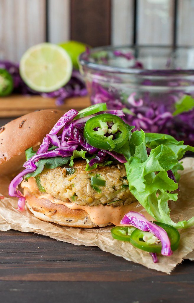 15 Healthy Burger Recipes, Meat and Meatless.  Everything from beef and turkey to salmon and black.  There is something for everyone! Spicy Chickpea Veggie Burgers with Jalapeño and Zucchini Slaw