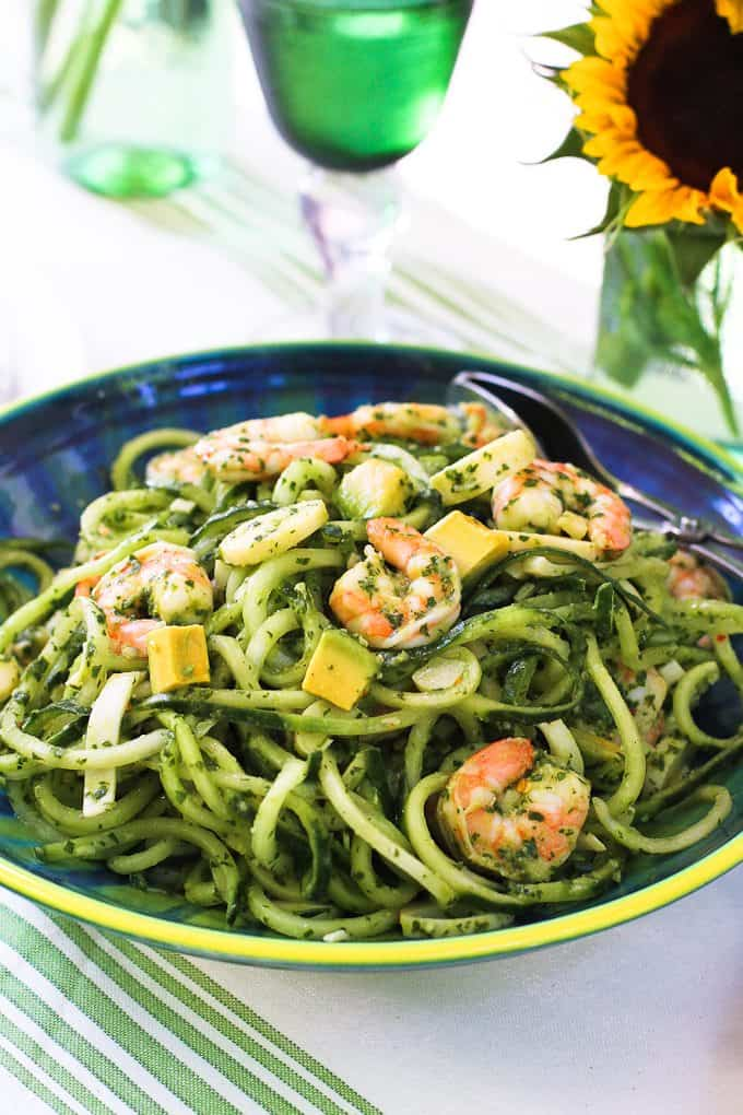 Chimichurri cucumber noodles are fantastic on their own, but when you add creamy avocado, shrimp and hearts of palm, you have a magical summertime dinner recipe. 245 calories and 5 Weight Watchers Freestyle SP #cleaneating #shrimp