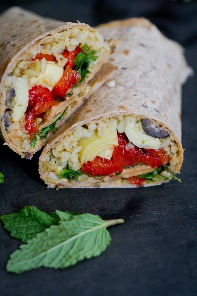 These Mediterranean Vegetable Wraps with Freekeh (a whole grain) are unbelievably good! Artichoke hearts, roasted peppers and spinach are all a great way to #VegItUp! 334 calories and 9 Weight Watchers SmartPoints