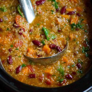 This Slow Cooker Bean Soup with Quinoa and Sweet Potatoess is packed with fiber and flavor. Throw everything in the crockpot and walk away! 218 calories and 4 Weight Watchers Freestyle SP