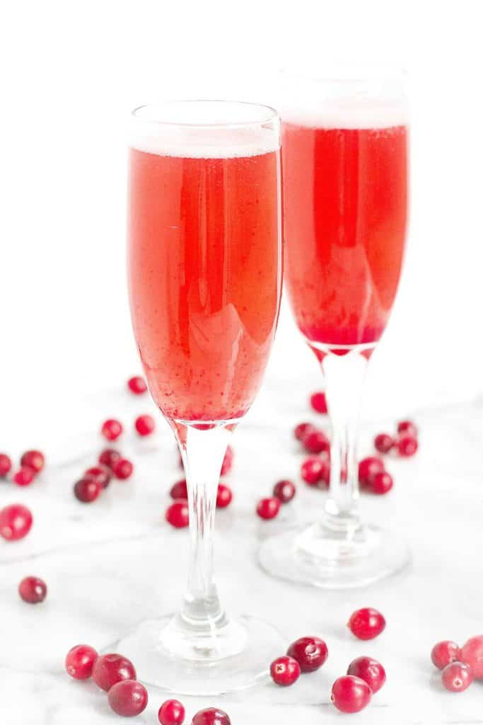 Raise a glass to the holidays with this Cranberry Prosecco Cocktail! Nothing but natural sweeteners in the syrup. 197 calories and 8 Weight Watchers SmartPoints