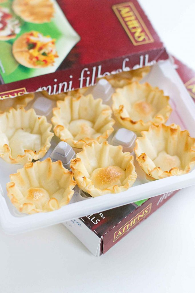 There is a wonderful balance of sweet and savory in these Roasted Grape and Ricotta Phyllo Cups. The perfect appetizer bites! 57 calories and 1 Weight Watchers SmartPoints