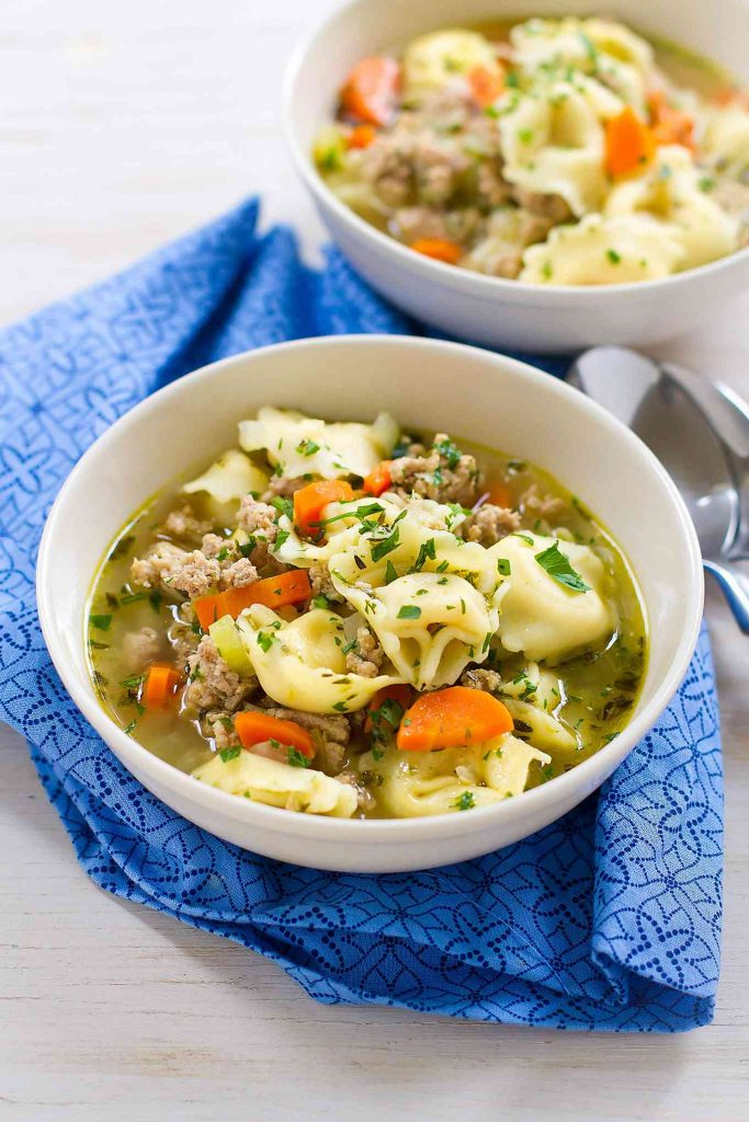 30 minute meal! This healthy Pesto Turkey Tortellini Soup recipe makes cooking easy! 230 calories and 4 Weight Watchers Freestyle SP #soup #healthyrecipes #weightwatchers
