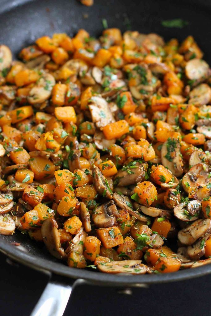 Sauteed butternut squash, mushrooms and herbs in a nonstick skillet.