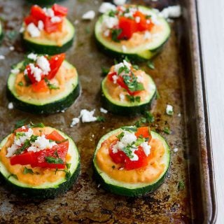 These Baked Zucchini Hummus Bites are fantastic for healthy snacking or appetizers! Vegetarian and gluten free. For 2 bites…39 calories and 1 Weight Watchers Freestyle SP