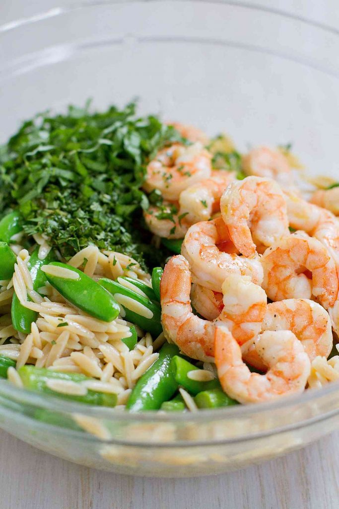 This Primavera Pasta Salad with Shrimp is fantastic for a light dinner or a picnic lunch! Packed with asparagus and snap peas. 292 calories and 6 Weight Watchers Freestyle SP