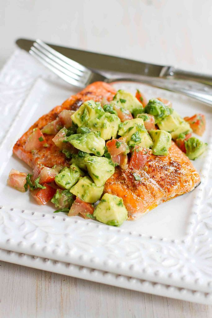 This amazing Roasted Salmon with Avocados Salsa recipe comes together in just 15 minutes. Fantastic for entertaining or an easy weeknight meal. 345 calories and 7 Weight Watchers SmartPoints