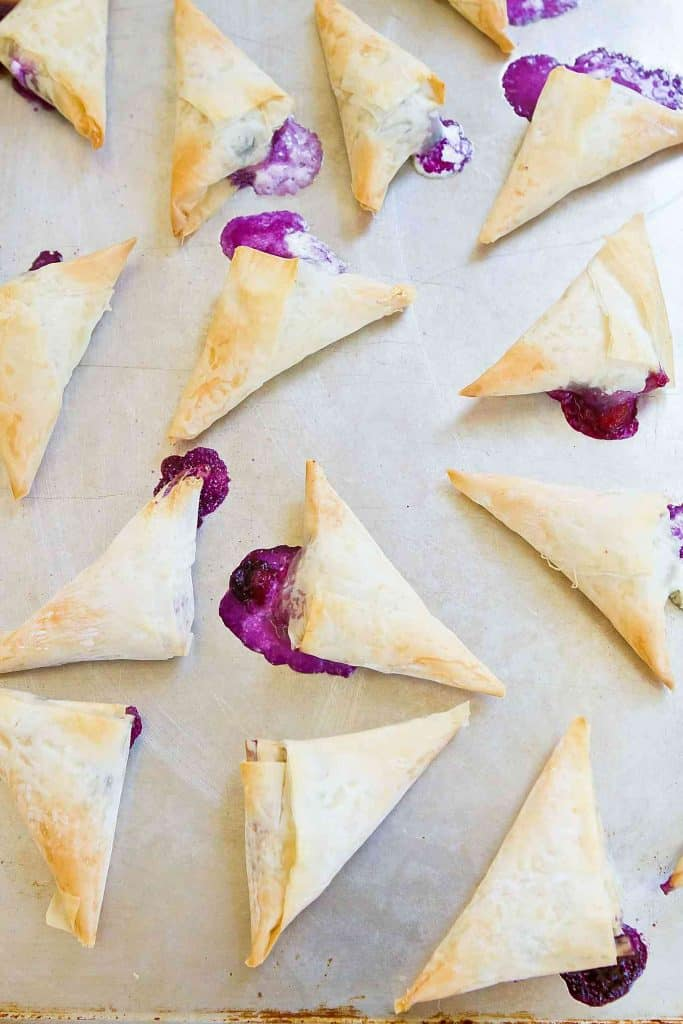 These 4-Ingredient Blueberry Goat Cheese Phyllo Turnovers make the most irresistibly flaky and delicious desserts or appetizers. 54 calories and 2 Weight Watchers SmartPoints