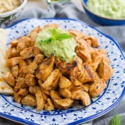 This Grilled Chicken Shawarma with Avocado Tzatziki is fantastic on its own or when served up with pita bread and hummus! 300 calories and 6 Weight Watchers SmartPoints