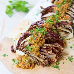 This smoky grilled radicchio is dressed up with an easy olive orange tapenade that is bursting with flavor! 85 calories and 2 Weight Watchers SmartPoints