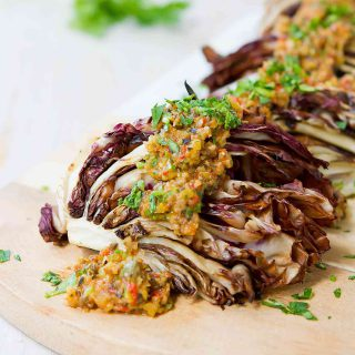 This smoky grilled radicchio is dressed up with an easy olive orange tapenade that is bursting with flavor! 85 calories and 2 Weight Watchers Freestyle SP
