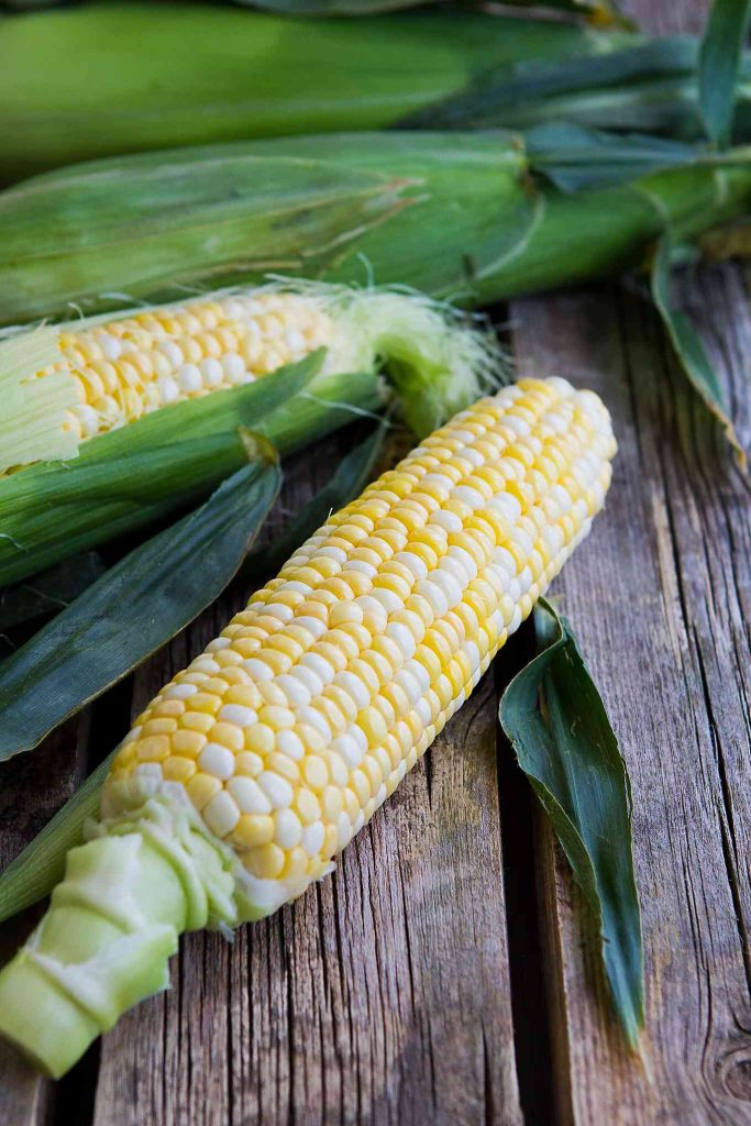 Sweet corn on the cob is made even better with a dollop of pesto butter. The perfect summertime side dish recipe! 118 calories and 5 Weight Watchers SmartPoints