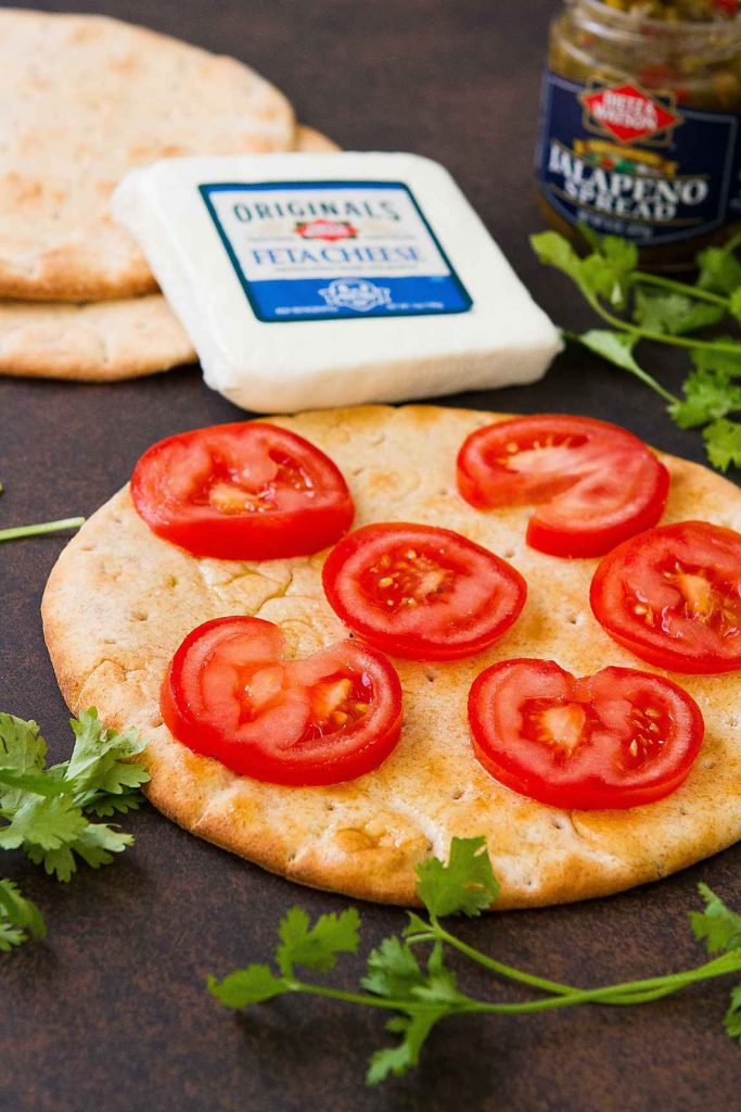 This Feta Jalapeno Tomato Flatbread is fantastic for a spur of the moment meal or as an easy appetizer to share with friends. 172 calories and 6 Weight Watchers Freestyle SP