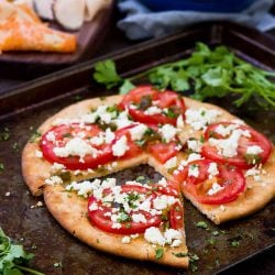 This vegetarian Feta Tomato Jalapeno Flatbread is fantastic for a spur of the moment meal or as an easy appetizer to share with friends. 172 calories and 5 Weight Watchers SmartPoints