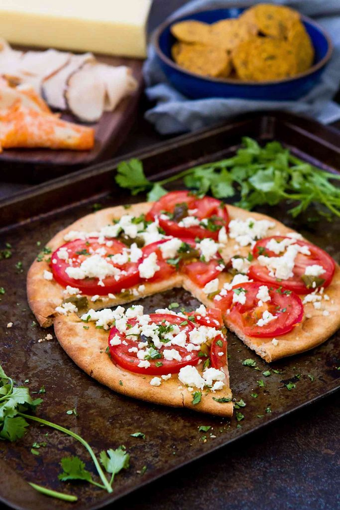 This vegetarian Feta Jalapeno Tomato Flatbread is fantastic for a spur of the moment meal or as an easy appetizer to share with friends. 172 calories and 5 Weight Watchers SmartPoints