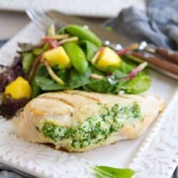 Impress your guests with these surprisingly easy Grilled Spinach Artichoke Stuffed Chicken Breasts! 284 calories and 6 Weight Watchers SmartPoints