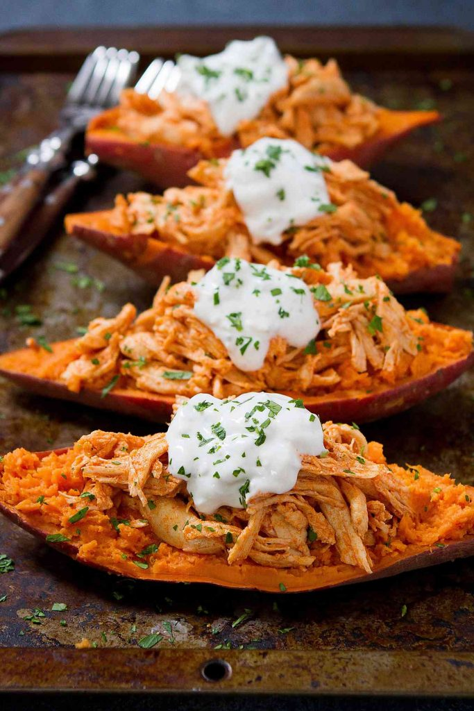 20 minute meal! These Buffalo Chicken Stuffed Sweet Potatoes are topped with a light blue cheese yogurt sauce. An easy weeknight dinner recipe! 239 calories and 4 Weight Watchers Freestyle SP
