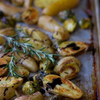 Crispy roasted fingerling potatoes with Brussels sprouts and a balsamic glaze are perfect for any holiday or wintertime meal. 136 calories and 4 Weight Watchers Freestyle SP