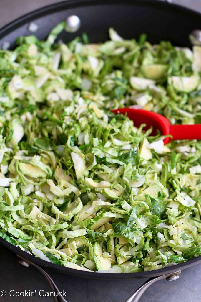 Shredded Brussels sprouts sauteing in the pan