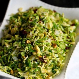 Shredded Brussels sprouts are an easy and colorful side dish for Thanksgiving. Tons of flavor from the pistachios, dried cranberries & Parmesan! 83 calories and 3 Weight Watchers Freestyle SP