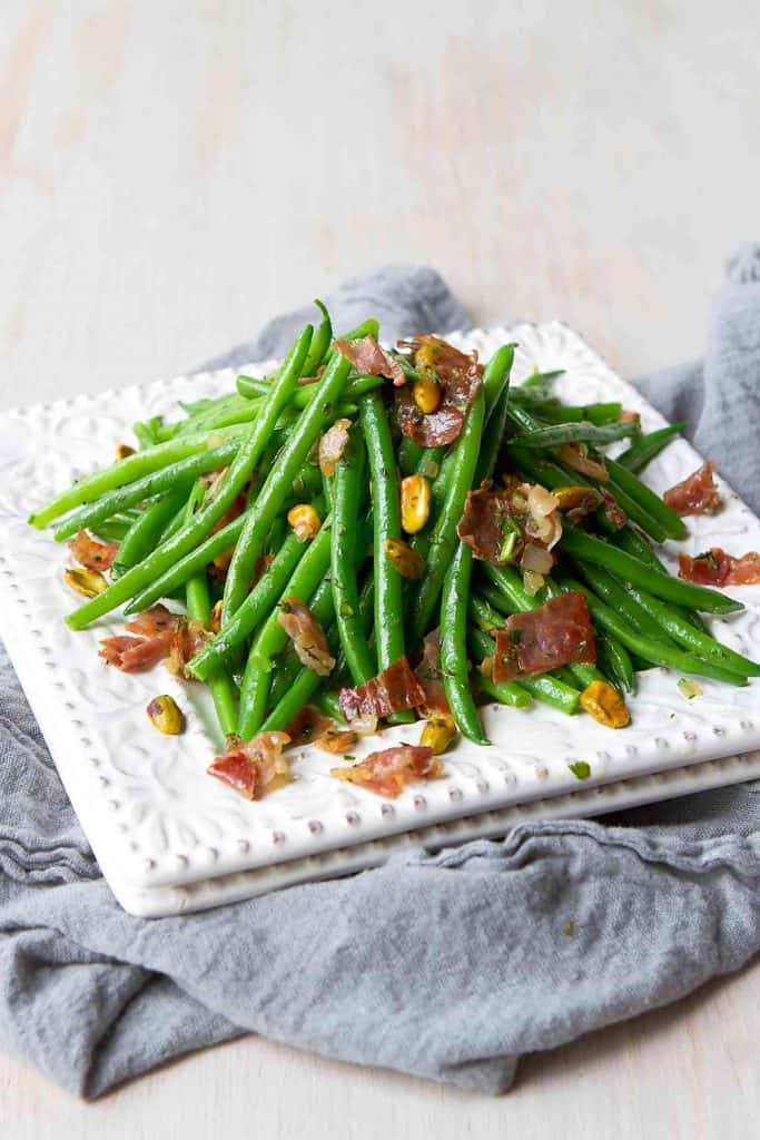 These Easy Green Beans with Prosciutto and Pistachios are a fantastic side dish for your holiday meal! 91 calories and 2 Weight Watchers Freestyle SP