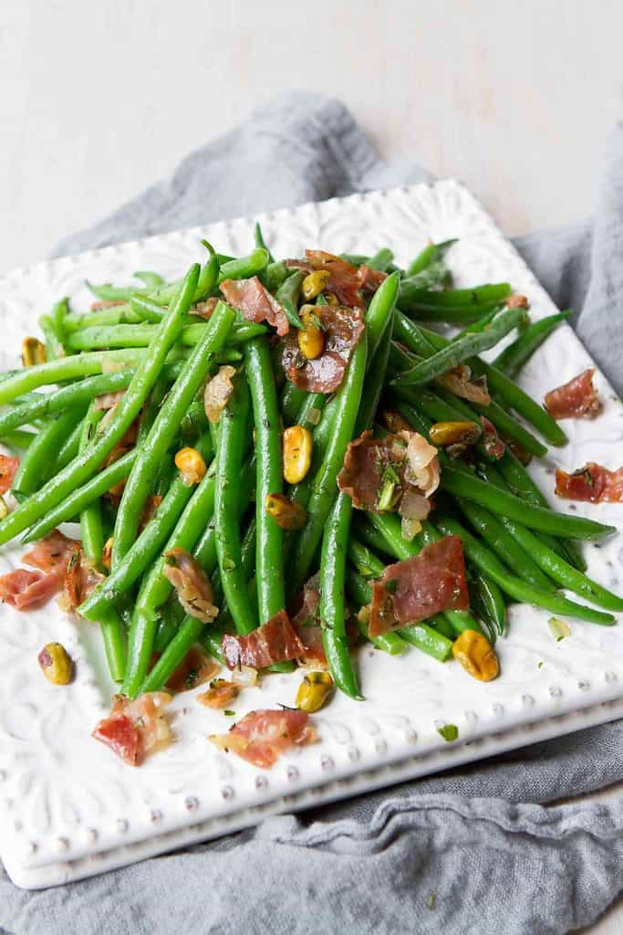 This recipe for green beans is packed with flavor from crispy prosciutto and toasted pistachios. A fantastic holiday side dish! 91 calories and 2 Weight Watchers Freestyle SP