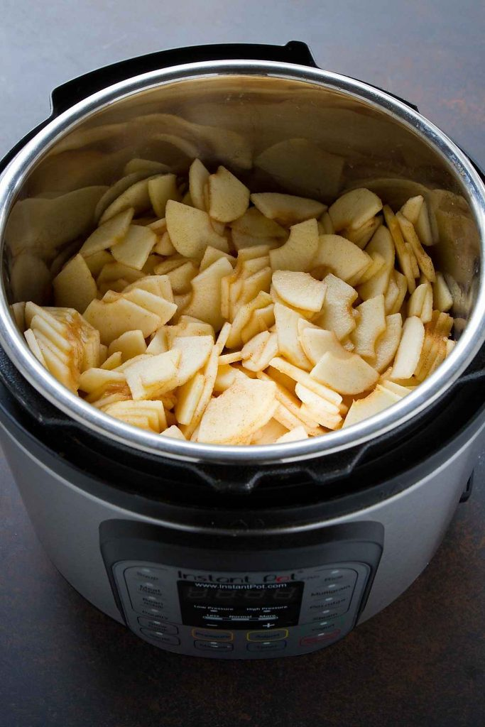 Peeled, cored and sliced apples in an Instant Pot pressure cooker.