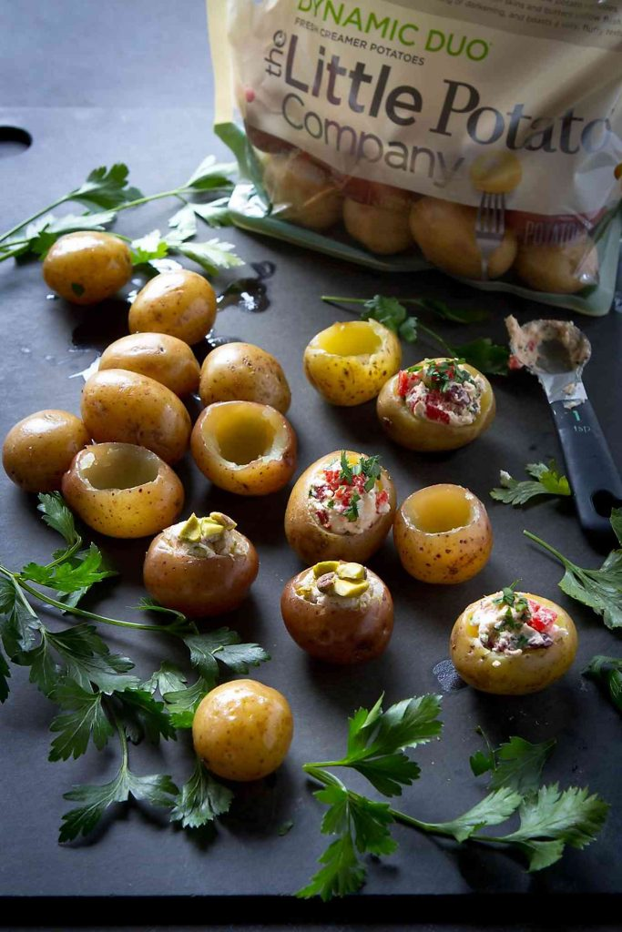 Stuffing Little Potato Company Creamer potatoes with sweet and savory goat cheese fillings.