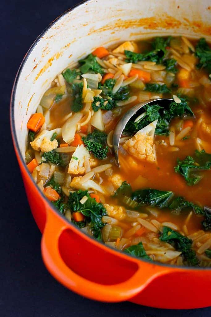 Whole Wheat Orzo, Cauliflower and Kale Soup {Vegan}...A fantastic, hearty soup that's packed with vegetables! 205 calories and 5 Weight Watchers SmartPoints #cleaneating