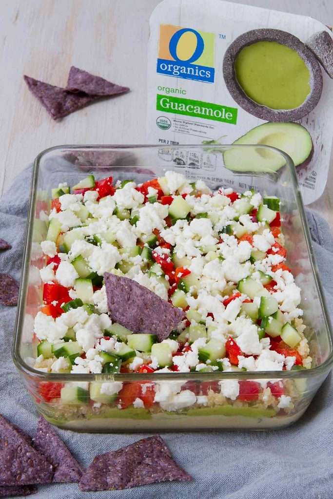 Need a healthy afternoon snack or a tailgating dish? This Healthy Quinoa Guacamole 7-Layer Dip is positively addictive and so easy to put together! 111 calories and 3 Weight Watchers SP