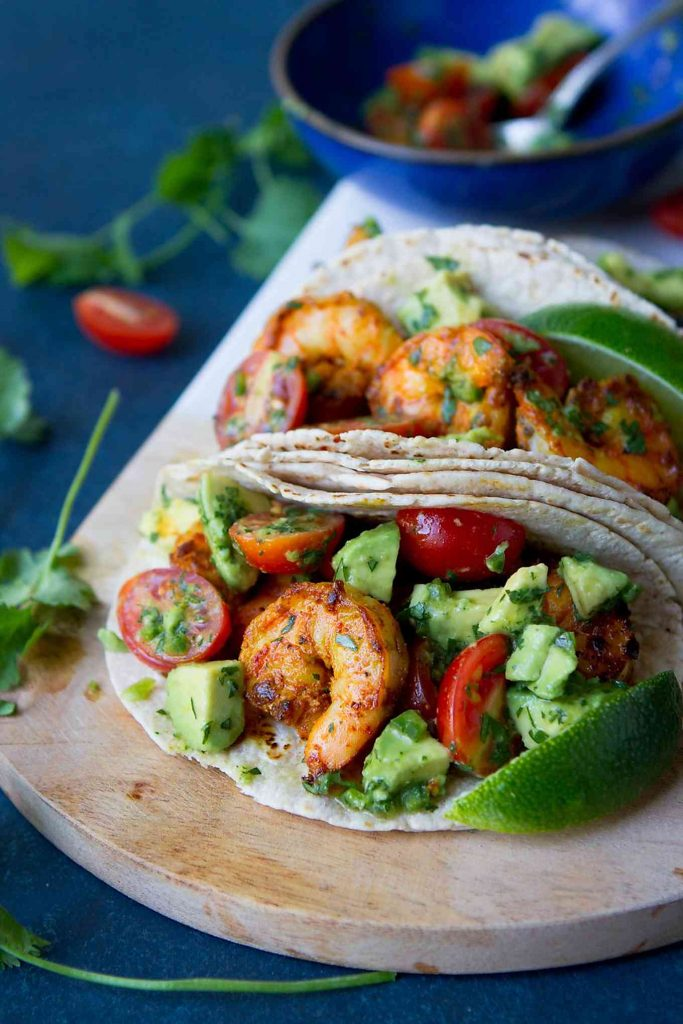 Line up this healthy shrimp taco recipe for Taco Tuesday! The Indian spices and avocado salsa boost the flavor and nutrients. 254 calories and 6 Weight Watchers Freestyle SP