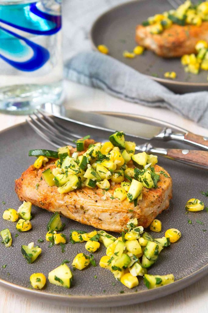 Broiled boneless pork chops are an easy and healthy meal for any night. Top them with a sautéed salsa made of zucchini, corn and lime juice. 323 calories and 4 Weight Watchers Freestyle SP